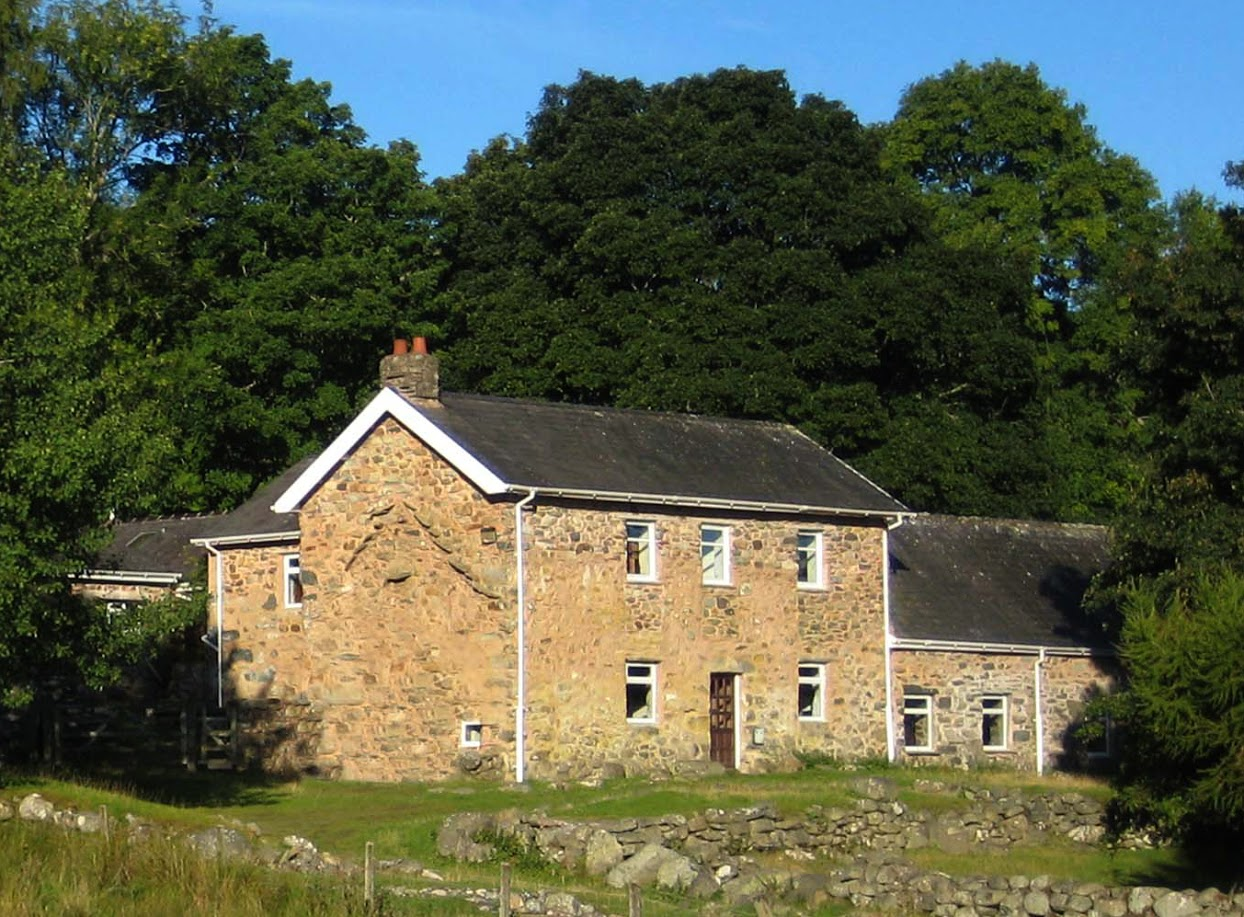 photograph of Bron-y-Gader front exterior nestled in green trees
